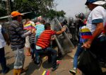 The EU condemns the use of armed groups and says it is ready to send more aid to Venezuela
